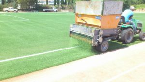 Infill machine with green rubber infill