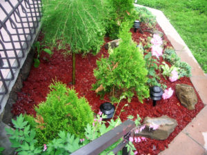 flower patio with red bark rubber mulch